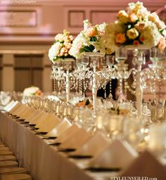 Elegant Wedding Table with White and Pink Flowers and gorgeous reception room lighting