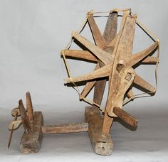 "Spinning wheel (""charkha"") (twenty-one pieces); carved of wood"