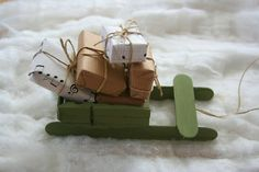 Christmas sleigh made from tongue depressors and clothes pins TUTORIAL