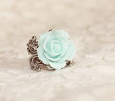 Turn heads with this handmade vintage-style rose cabochon ring. The Ellah Ring is the perfect cocktail or statement ring. Vintage feel and classic style! This gorgeous rose ring is sure to make a statement.    The lovely rose {about 1 inch wide} is securely attached to an adjustable silver filigr...