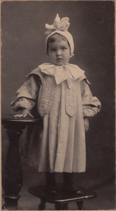 sweet little girl. Darling hat and bow. And interesting coat construction.