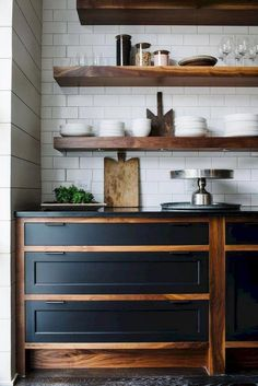 Gorgeous black and wood kitchen cabinets with open shelving and white subway tile. Gorgeous black and wood kitchen cabinets with open shelving and white subway tile. Farmhouse Kitchen Cabinets, Painting Kitchen Cabinets, Farmhouse Kitchens, Kitchen Cabinetry, Wood Shelves In Kitchen, Kitchen Appliances, Plywood Kitchen, Craftsman Kitchen, New Kitchen