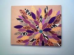I made this by painting a canvas tan, cutting out flower petals in different colors & patterns, and glueing them in a flower arrangement. I used a thin layer of Mod Podge over the entire picture when I was done.