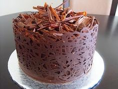 http://www.youtube.com/watch?v=vPpo373F5qk    Love this chocolate band around cake! It's easier than it looks...great tutorial!