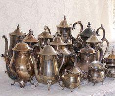 Silver teapots, cream & sugar with tarnish
