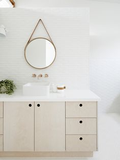 Our All Oak Mirror in a bathroom at Kay House - Interiors by Simone Haag