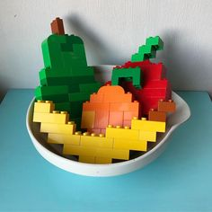 A fruit a day keeps the doctor away. A fruit basket made with Lego Duplo. A pear, apple, orange and Duplo banana. Very tasty! #fruit #fruits #fruitbasket