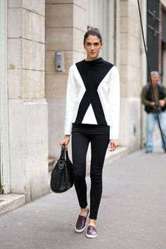 Black and white pants and top with red sneakers.