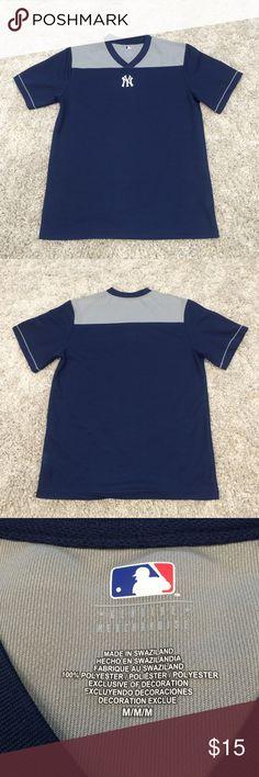 New York Yankees shirt size medium New York Yankees shirt size medium. 100% Polyester, brand new without tags. Yankees symbol embroidered at bottom of V neck. No stains rips or holes. Smoke free home. MLB New York Yankees  Shirts