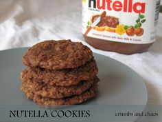 Crumbs and Chaos: Nutella Cookies.  4 ingredients (I dropped the added sugar because Nutella is already so sweet).  Delicious, easy.