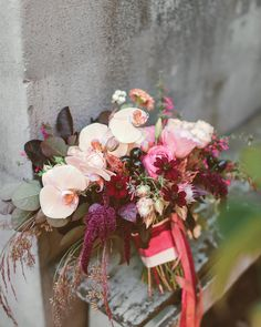 Pink and burgundy ribbons anchored this arrangement of Phalaenopsis orchids, garden roses, smoke bush, and chocolate cosmos, designed by McKenzie Powell for Jessica and Kirk's fall fete in Seattle.