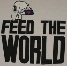 Vintage 1990s Snoopy Feed the World T-Shirt. Very good Pre-owned condition.