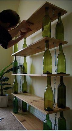I love the use of these glass bottles to help makes shelves, also seen it used for the legs on a table. Imagine hat pretty glass bottles you could use!