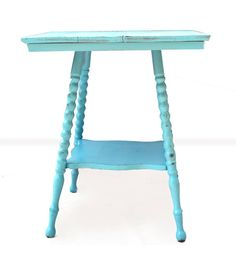 This was a unique find that came from an abandoned old home in Akron, Ohio. After careful sanding, paint, and some TLC, this accent table makes a perfect addition to any cottage style room. The details of the legs, shape of the top, lower shelf, and beautiful robins egg blue color provides a one-of-a-kind look. Add a few books, a candle, a Boston Fern and voila...cottage shic!