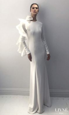 Livné White 2019 Wedding Dress - Eden Bridal Collection -MELISSA | Unique and simple wedding gown with sleeves | Modest bridal gown | Couture Dress | #weddingdress #weddingdresses #bridalgown #bridal #weddinggown #bridetobe #weddings #bride #weddinginspiration #weddingideas #fashionistas #blog #couture #dress See more gorgeous wedding gowns by clicking on the photo