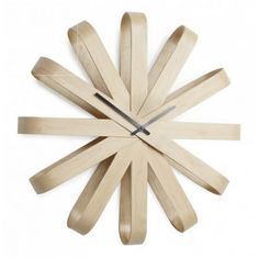 Find the shapely Ribbonwood Clock made of bent wood with modern appearance made by Umbra, avialable in the home design shop.