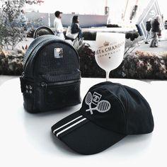 Tennis + Chanel hat + MCM mini backpack | US OPEN Instagram @modernbanks