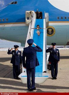 (3) Air Force One-Humor-Photoshoped-Michelle Obama water sliding...