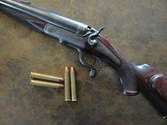 """Nitro Express """"Elephant Stopper Gun"""" The Nitro Express was descended from the Black Powder Express, a cartridge invented by the late Samuel Baker who had Holland & Holland build him an express rifle in this caliber. Nitro Express, Elephant Gun, Fire Powers, Firearms, Shotguns, Hunting Rifles, Cool Guns, Guns And Ammo, Hand Guns"""