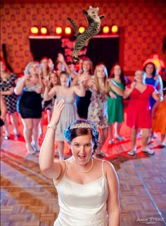 Brides Throwing Cats Instead of Flower Bouquets I hope it's photo manipulation .......