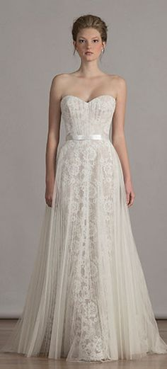 Designer Carlos Ramirez's bridal gowns combine feminine silhouettes with the use of luxurious fabrics, sumptuous textures and exquisite hand-work detail.
