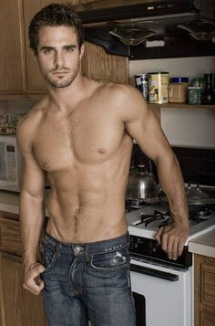 Cooking...Well, he's standing in front of the stove, so we can imagine... [actor and model Marco Dapper]