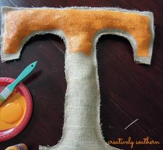 Easy Burlap Football Decor! OR D Make the letter of your last name and paint the color you wish and use on your fall wreath....that is what I am doing this year....S.S.T.