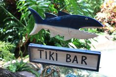 """Here is a sign that has been hand carved and hand painted """"Tiki Bar"""". It's a great piece of home decoration! Specifications: - Measurement: 15 inches long X 10 inches tall (38 cm X 25 cm) - Type: wood"""