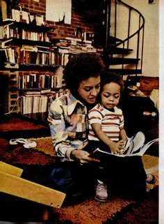 Nikki Giovanni reads to her son.