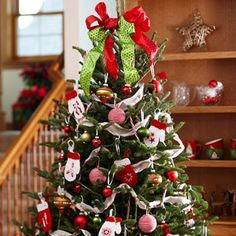 "How to Decorate a Christmas Tree from Better Homes & Gardens  ### There are no firm rules when draping garlands on your Christmas tree. To avoid the ""sausage effect"" (branches bulging between tightly cinched garlands), start at the top of the tree and slowly increase the amount of garland between each wave as you work your way down the branches. Plan to use about two strands of garland for every vertical foot of tree."