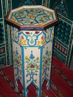 Biege Painted Tall Wood Table By Treasures of Morocco by Moroccan Furniture. $170.00. Ideal for your Moroccan decor. Free Shipping. Measurement: 27 inch High x 16inch WIDE. Octagon end table from Wood for living room or bedside use. Hand made Wood construction with vibrant colores. Our craftsmen used antique colors to give this coffee table a unique style with the outlines of Moorish arches that will provide you with an elegant decor.