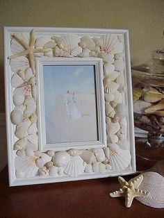 Seashell Frame~Make this after collecting shells on our 30th anniversary trip.  Place a picture from our trip in the frame!