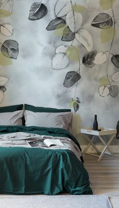 Dark and moody, this Spring-time wallpaper is like no other. Softly drawn leaves hang freely in this wallpaper design, adding a dreamy element to your home. Pair with green furnishings to complete the natural look.