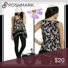FLORAL SKULL GIRLS WOVEN SHARK BITE TANK We love how the details on this tank top make it perfect for summer! The pink and purple floral print flowy black tank has skulls mixed in for the perfect combination of tough and girly. The sharkbite hem has a black crochet panel an inch from the hem to add contrast.   100% rayon Wash cold gentle cycle; line dry Color:BLACK PINK & PURPLE Hot Topic Tops
