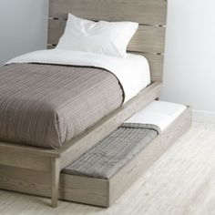 """Wrightwood Trundle Bed doubles as an extra bed for sleepovers or as under-bed storage. A Blake Tovin designIncludes five wooden slats to provide support when used as a bedThree wooden boards provide a base for storage useMulti-step finish may vary slightly piece to pieceMade in VietnamSolid ash, ash veneer, and low emission engineered woodShipping includes in-home setupRequires a 5"""" trundle mattress (sold separately)Will not accommodate a twin mattress."""