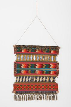 Woven Wall Hanging-Would be an easy DIY with fabric, cardboard, paint, sticks!