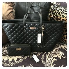 BCBG BLACK QUILTED TOTE w/ DUST BAG Authentic BCBG Black Quilted Tote with dust bag and matching wallet!! BNWT! Never used! Perfect for everyday use or on the go! BCBG Bags Totes