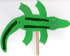 Alligator on a Stick: I swear googly eyes and metal brads make everything more f… - Top-Trends Alphabet Crafts, Vbs Crafts, Camping Crafts, Craft Stick Crafts, Diy Crafts For Kids, Arts And Crafts, Paper Crafts, Alligator Crafts, Alligator Party