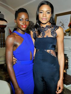 Let the Oscars Parties Begin! | BOLD & BEAUTIFUL | Is it possible for Lupita Nyong'o to not look flawless? Shining bright in royal blue, the actress poses with fellow beauty Naomie Harris at the LoveGold Cocktail Party, where the Academy Award nominee was honored.