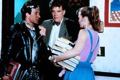 Plain Clothes (1988).  A plain clothes detective goes undercover in a high school and uses the library to solve a murder.