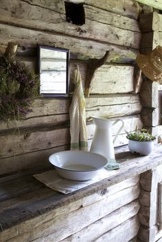 Cabin life - wash bowl & jug on a hand hewn timber shelf