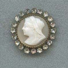 Looks like jewelry but it isn't - its a Gorgeous Antique Button 1800's Cameo Image w Rhinestone Border Paris Marking on Back.