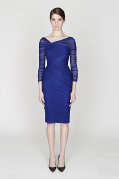 Love the color and the wrap style dress by Monique Lhuillier