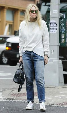 Dakota Fanning went back to dressed down casual look during her outing in New York City after making a head turning appearance in a gothic dress on the red carpet at the Met Gala. She went for a typical casual look comprising of sweater and boyfriend jeans as she stepped out to grab a coffee in NYC on May 5, 2016.