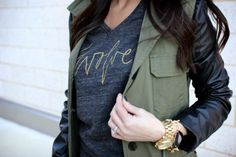 i love the look of the two-tone jacket with the watch and bracelets. urban utilitarian look.