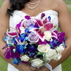Lots of color in today's Colorado wedding. Gorgeous shades of blue, purple, and pinks!