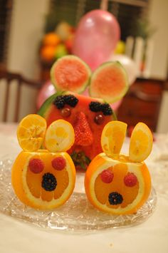 Cute animal faces made from fruit. I want to make a lion one with the orange peel as the mane!