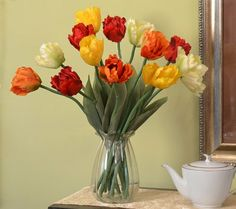 Designer Parrot Tulip bouquet (Stems Only) Place these lovely silk parrot tulips in your favorite glass, ceramic or pottery vase for a quick, elgant floral design. Using stems is a cost effective way to spruce up a room. The vase is not included.