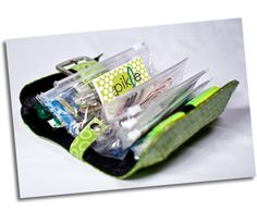In A Pickle bag. Super cute bag filled with EVERYTHING you could ever need when in a jam.