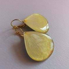 Check out this item in my Etsy shop https://www.etsy.com/listing/492640626/ready-to-ship-pale-yellow-earrings
